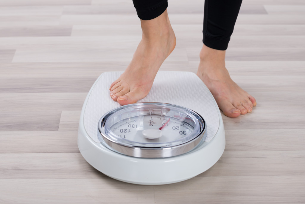 Standing On Weighing Scale